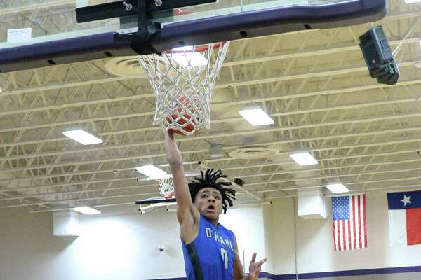 Micah Peavy of Dekaney shoots in the second half of a boys basketball game between the Morton Ranch Mavericks and Dekaney Wildcats during the Katy ISD-Phillips 66 Tournament on Thursday December 1, 2016 at Morton Ranch, Katy, TX.