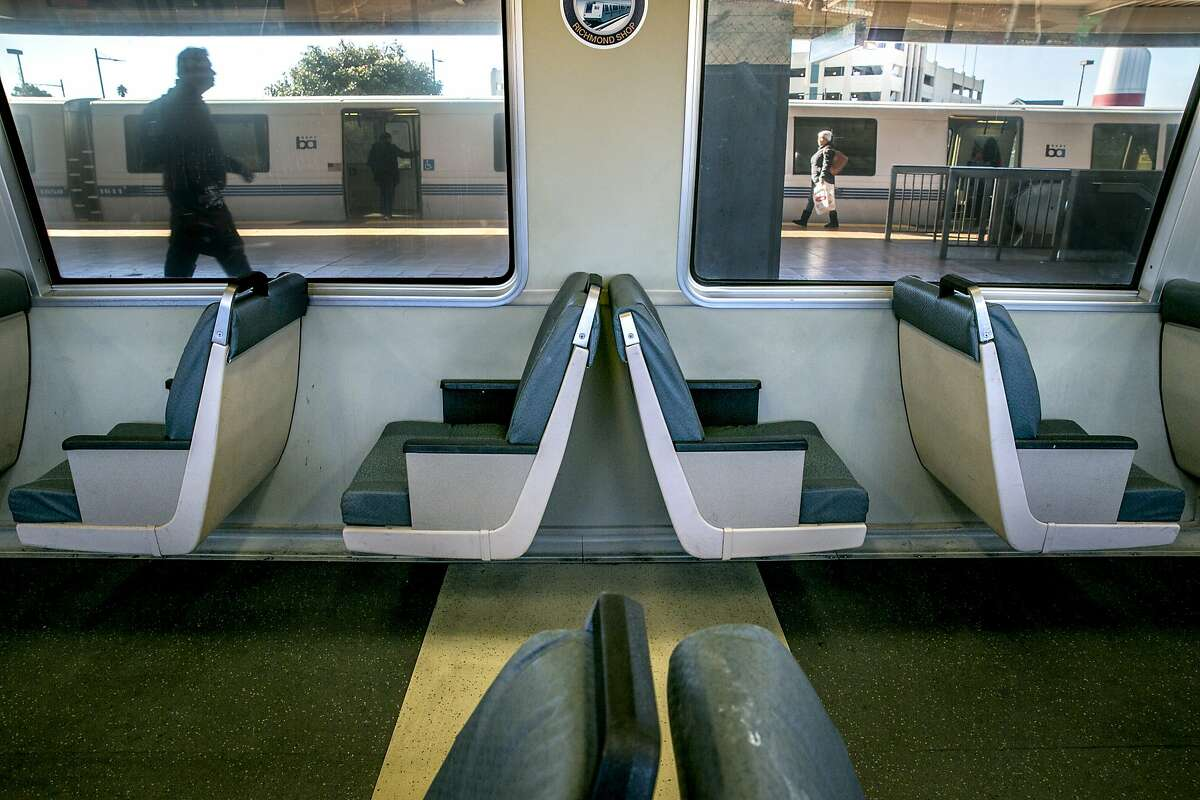 People walk inside the Richmond BART Station on on Thursday, Dec. 1, 2016 in Richmond, Calif. On this 4-car train, one of the cars has been modified with a row of single-passenger seats.