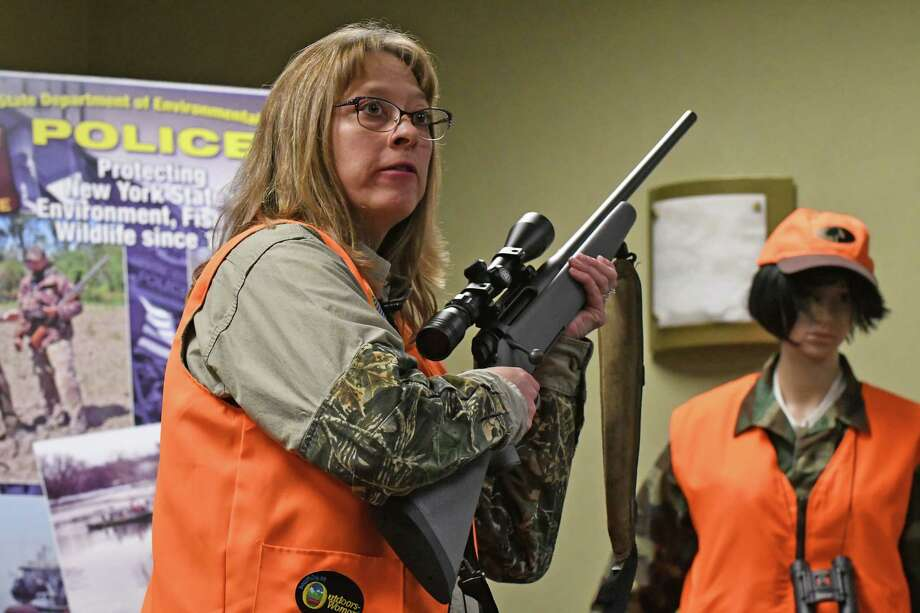 NY DEC Sportsman Education instructor Colleen Kimble gives a gun safety demonstration on Thursday, Dec. 1, 2016, in Albany, N.Y.  (Michael P. Farrell/Times Union) Photo: Michael P. Farrell / 20039016A