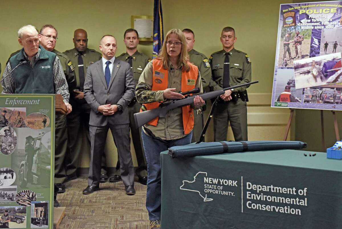 NY DEC Sportsman Education instructor Colleen Kimble gives a gun safety demonstration on Thursday Dec. 1, 2016 in Albany, N.Y. (Michael P. Farrell/Times Union)