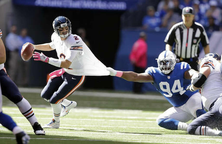 Chicago Bears quarterback Brian Hoyer (2) tries to pull away from Indianapolis Colts defensive end Zach Kerr (94) during the first half of an NFL football game in Indianapolis, Sunday, Oct. 9, 2016. (AP Photo/Darron Cummings)