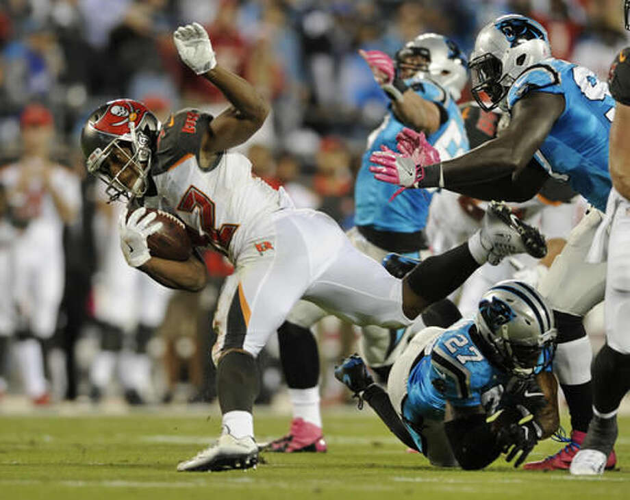 Tampa Bay Buccaneers' Jacquizz Rodgers (32) is tackled by Carolina Panthers' Robert McClain (27) in the first half of an NFL football game in Charlotte, N.C., Monday, Oct. 10, 2016. (AP Photo/Mike McCarn)
