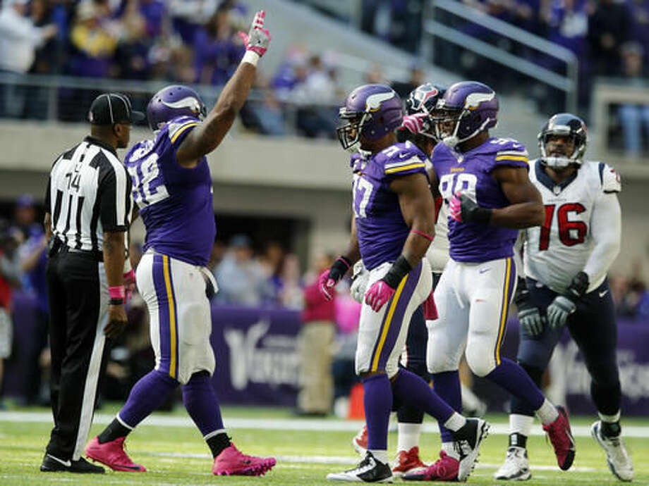 Minnesota Vikings defenders Tom Johnson, from left, Everson Griffen and Danielle Hunter celebrate after sacking Houston Texans quarterback Brock Osweiler during the second half of an NFL football game Sunday, Oct. 9, 2016, in Minneapolis. The Vikings won 31-13. (AP Photo/Jim Mone)