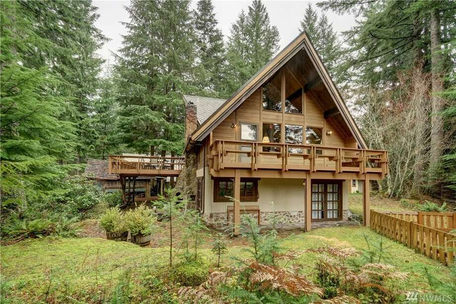 16016 Crystal Lane E. is off Highway 410 near Greenwater, Wash. It is on the edge of Mt. Rainier National Park.The two bedroom, 2.75 bathroom cabin has been meticulously kept, and currently used as a vacation-rental property. It is 1,700 square feet and features 155 feet of White River frontage. The second floor has a large master bedroom while the downstairs bedrooms can sleep up to 10. The property is listed for $550,000.  Photo: Photos By Dana Kehr/TourFactory, Listing Courtesy Phyllis Hartford, Mountain View Properties