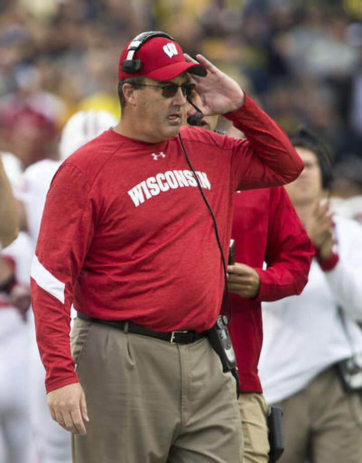 FILE - In this Oct. 1, 2016, file photo, Wisconsin head coach Paul Chryst walks the sidelines in the third quarter of an NCAA college football game against Michigan in Ann Arbor, Mich. Clearly, No. 2 Ohio State and No. 4 Michigan have been the class of the Big Ten so far. No. 8 Wisconsin and No. 10 Nebraska, though, will get a chance to prove the conference isn't the Big Two and Little Eight like it used to be years ago with the Buckeyes and Wolverines playing on another level. (AP Photo/Tony Ding, File)