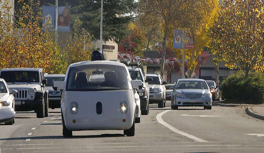 A Google self-driving car drives behind Delphi during a test drive on Thursday, December 1, 2016,  in Mountain View, Calif.  Delphi is one of the world's largest makers of automotive parts. Photo: Liz Hafalia, The Chronicle