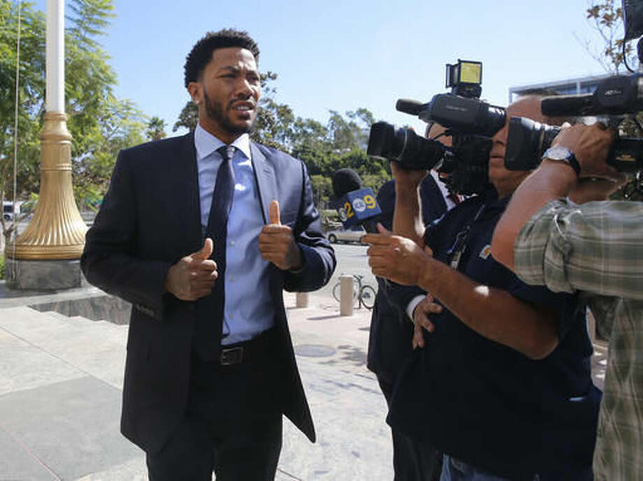 FILE - In this Thursday, Oct. 6, 2016, file photo, New York Knicks basketball player Derrick Rose arrives at U.S. District Court in downtown Los Angeles. NBA star Rose is set to return to the witness stand in a $21 million lawsuit that alleges he and two friends raped an incapacitated woman. Before Rose retakes the stand Tuesday, Oct. 11, a judge will consider a mistrial request from Rose's lawyer. (AP Photo/Damian Dovarganes, File)