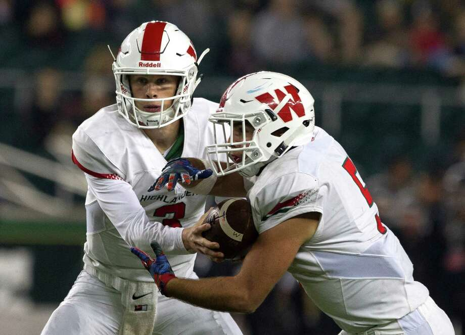 The Woodlands quarterback Eric Schmid (3) hands the ball off to running back Carlos Ramos (5) during the third quarter of a Class 6A Division I regional semifinal game at McLane Stadium Saturday, Nov. 26, 2016, in Waco. The Woodlands defeated Austin Bowie 52-31. Photo: Jason Fochtman, Staff Photographer / Houston Chronicle