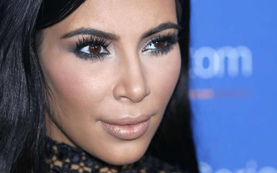 "FILE - In this June 24, 2015, file photo, Kim Kardashian West poses during a photo call at the Cannes Lions 2015. An online retailer has pulled a Halloween costume that made light of the recent jewelry heist involving Kardashian West. The costume prompted outrage from some social media users. The company's Twitter account announced Tuesday, Oct. 11, 2016, that the costume had been pulled and apologized if it ""offended anyone."" (AP Photo/Lionel Cironneau, File)"