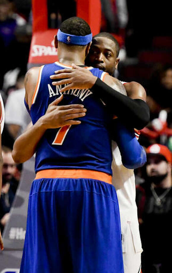New York Knicks forward Carmelo Anthony (7) and Chicago Bulls guard Dwyane Wade hug after an NBA basketball game Friday, Nov. 4, 2016, in Chicago. The Knicks won 117-104. (AP Photo/Matt Marton)
