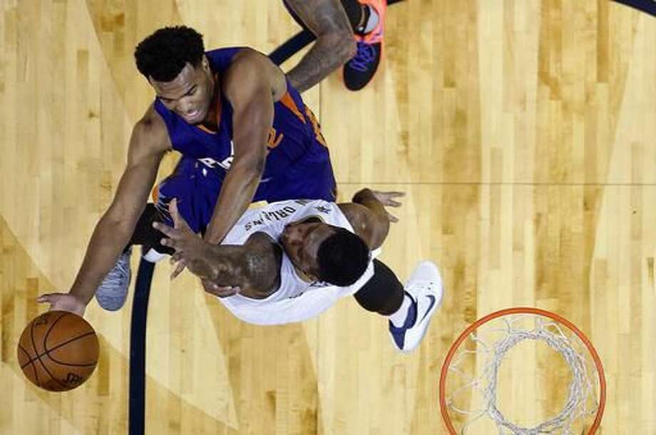 Phoenix Suns forward TJ Warren (12) shoots against New Orleans Pelicans forward Terrence Jones during the first half of an NBA basketball game in New Orleans, Friday, Nov. 4, 2016. (AP Photo/Gerald Herbert)