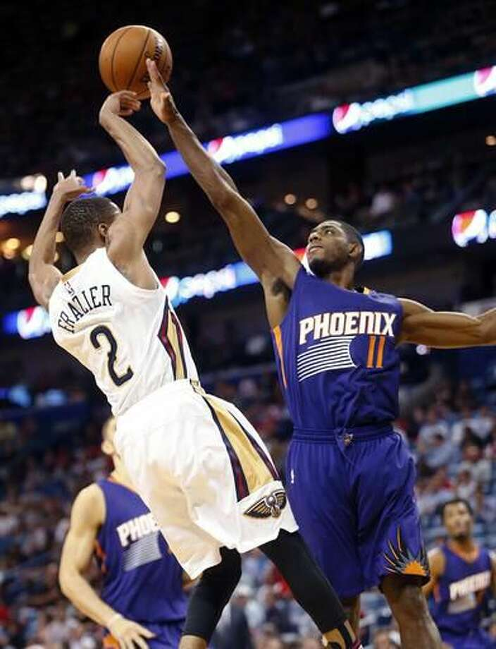 Phoenix Suns guard Brandon Knight (11) tries to block New Orleans Pelicans guard Tim Frazier (2) during the first half of an NBA basketball game in New Orleans, Friday, Nov. 4, 2016. (AP Photo/Gerald Herbert)