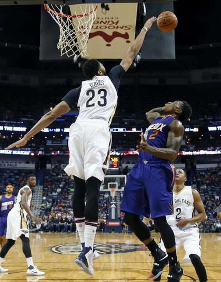New Orleans Pelicans forward Anthony Davis (23) blocks a shot by Phoenix Suns guard Eric Bledsoe (2) during the first half of an NBA basketball game in New Orleans, Friday, Nov. 4, 2016. (AP Photo/Gerald Herbert)