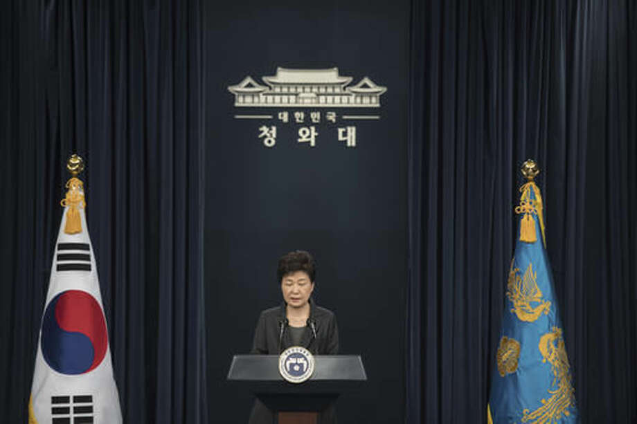 "South Korean President Park Geun-hye addresses the nation at the presidential Blue House in Seoul Friday, Nov. 4, 2016. Park took sole blame Friday for a ""heartbreaking"" scandal that threatens her government and vowed she will accept a direct investigation into her actions amid rising suspicion that she allowed a mysterious confidante to manipulate power from the shadows. (Ed Jones/Pool Photo via AP)"