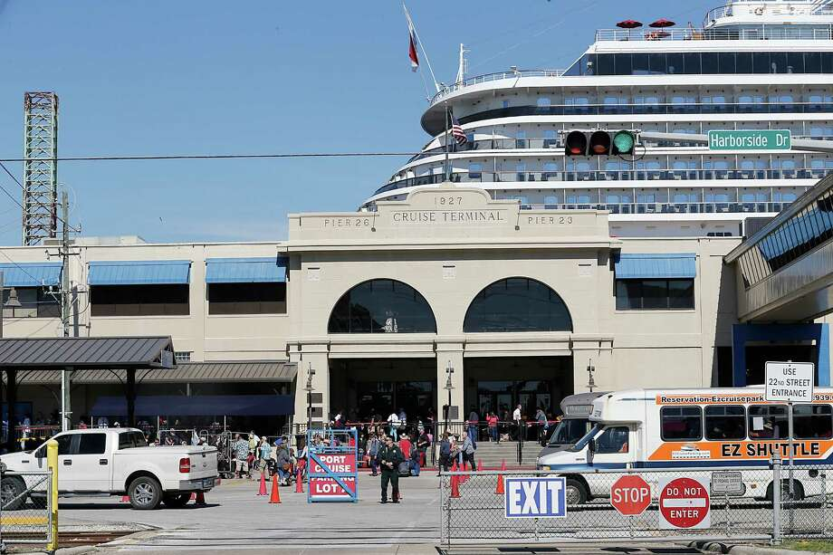 The Carnival Cruise Ship Magic Is Docked Next To A Passenger Area Of The  Port Of