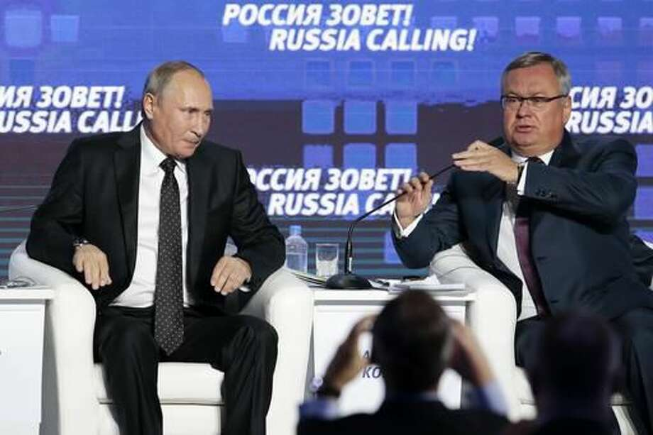 "Russian President Vladimir Putin, left, and VTB Bank Chairman Andrei Kostin attend the 8th annual VTB Capital ""Russia Calling!"" Investment Forum in in Moscow, Russia, Wednesday, Oct. 12, 2016.Russia's economy has been on its way down since it slipped into recession at the start of last year. (AP Photo/Ivan Sekretarev)"