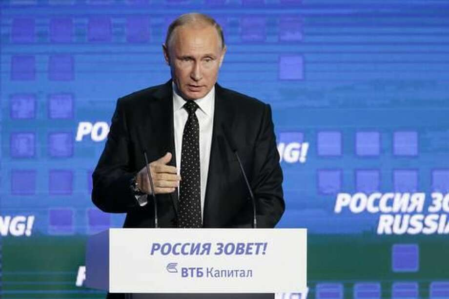 "Russian President Vladimir Putin gestures while speaking at the 8th annual VTB Capital ""Russia Calling!"" Investment Forum in in Moscow, Russia, Wednesday, Oct. 12, 2016.Russia's economy has been on its way down since it slipped into recession at the start of last year. (AP Photo/Ivan Sekretarev)"