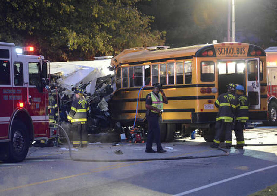 FILE - In this Tuesday, Nov. 1, 2016 file photo, fire department and rescue officials work at the scene of an early morning fatal collision between a school bus and a commuter bus in Baltimore. The Maryland Motor Vehicle Administration says the driver of a Baltimore school bus involved in a deadly crash with a commuter bus shouldn't have been driving the vehicle because his commercial license had been suspended two months earlier. Glenn Chappell, 67, was killed Tuesday, along with a Maryland Transit Administration bus driver and four mass transit passengers, when his school bus crossed the center line and smashed into the commuter bus. (Jeffrey F. Bill/The Baltimore Sun via AP, File)
