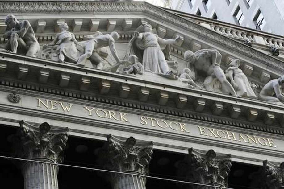 This Tuesday, Oct. 11, 2016, photo shows the New York Stock Exchange. Technology stocks led a broad reverse in global markets on Wednesday after Samsung downgraded its profit estimates and networks company Ericsson warned on its outlook. Investors will later look to the minutes of the U.S. Federal Reserve's last meeting for hints on how quickly interest rates might be raised. (AP Photo/Frank Franklin II)
