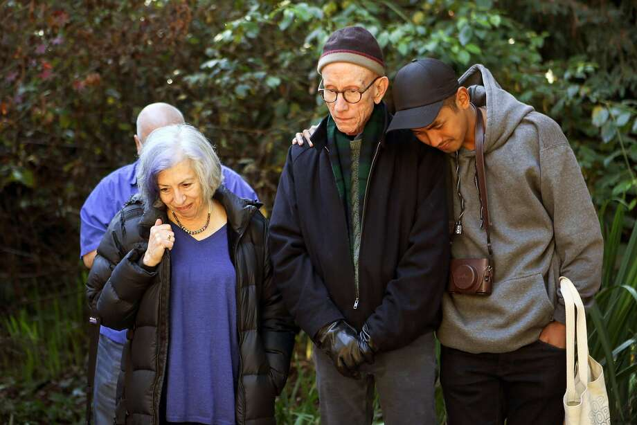 Alison Moed Paolercio (left), John Chard and Christopher Baguiolook view the name of Chard's partner, Steve Keith, at the National AIDS Memorial Grove in Golden Gate Park. Photo: Amy Osborne, Special To The Chronicle