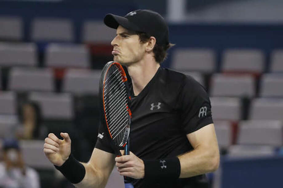Andy Murray of Britain reacts during the men's singles match against Steve Johnson of the United States in the men's singles match of the Shanghai Masters tennis tournament at Qizhong Forest Sports City Tennis Center in Shanghai, China, Wednesday, Oct. 12, 2016. (AP Photo/Andy Wong)