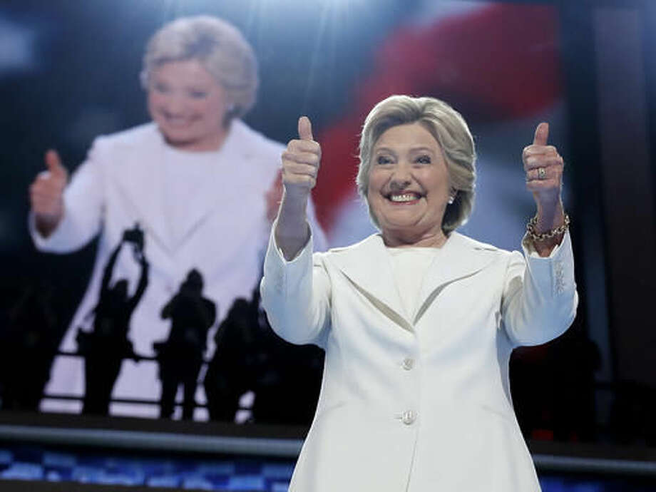 FILE - In this July 28, 2016, file photo, Democratic presidential candidate Hillary Clinton gives her thumbs up as she appears on stage during the final day of the Democratic National Convention in Philadelphia. Every presidential race has its big moments. This one, more than most. (AP Photo/Carolyn Kaster, file)