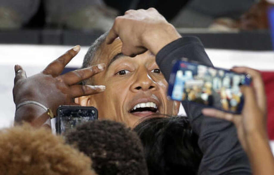 President Barack Obama greets supporters after speaking at a campaign rally for Democratic presidential candidate Hillary Clinton in Charlotte, N.C., Friday, Nov. 4, 2016. (AP Photo/Chuck Burton)