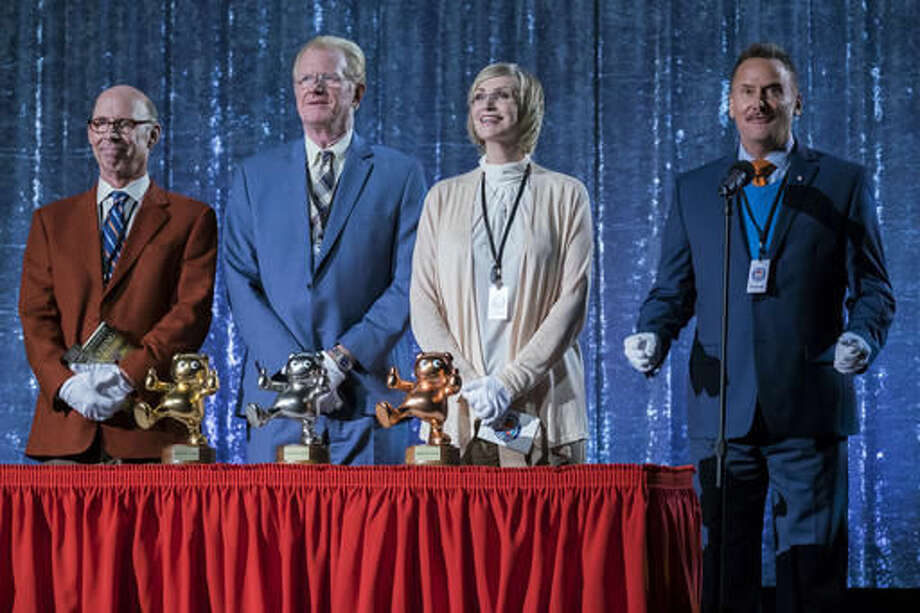 """This image released by Netflix shows, Bob Balaban, Ed Begley Jr., Jane Lynch and Michael Hitchcock in a scene from """"Mascots."""" (Scott Garfield/Netflix via AP)"""