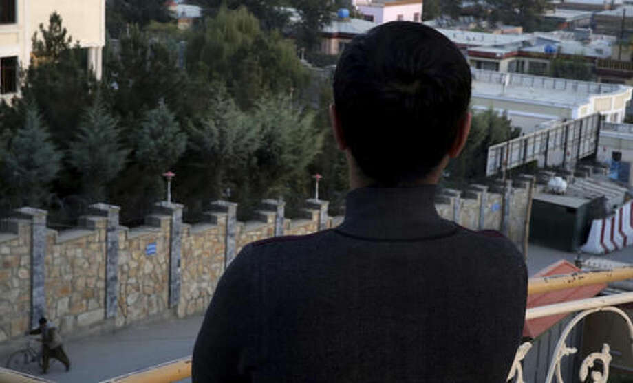 """In this Monday, Oct. 16, 2016 photo, Rameen, a young gay Afghan, poses with his back to the camera in Kabul, Afghanistan. To be homosexual in Afghanistan is to live in fear. Rameen and Naveed, another young gay man, have lost count of the number of times they've been lured into dangerous situations by men they believed they were meeting for dates. Both men describe being robbed, beaten up and blackmailed, and receiving death threats; they've even survived police """"honey traps"""" that could have seen them thrown in prison without charge, simply on suspicion of being gay. (AP Photos/Massoud Hossaini)"""