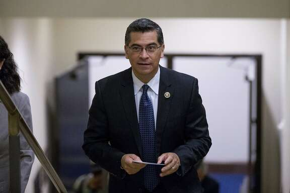 FILE - In this May 11, 2016 file photo Democratic Caucus Chairman Xavier Becerra, D-Calif., arrives for a news conference in Washington. California Gov. Jerry Brown named Becerra to replace Attorney General Kamala Harris, Thursday, Dec. 1, 2016. Becerra's nomination is subject to confirmation by the state Assembly and Senate. It will be officially submitted after Harris, who was elected to the U.S. Senate last month, resigns. (AP Photo/Andrew Harnik, File)