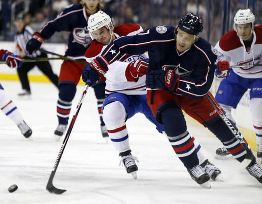 Montreal Canadiens forward Torrey Mitchell, left, works for the puck against Columbus Blue Jackets defenseman Jack Johnson during the first period of an NHL hockey game in Columbus, Ohio, Friday, Nov. 4, 2016. (AP Photo/Paul Vernon)
