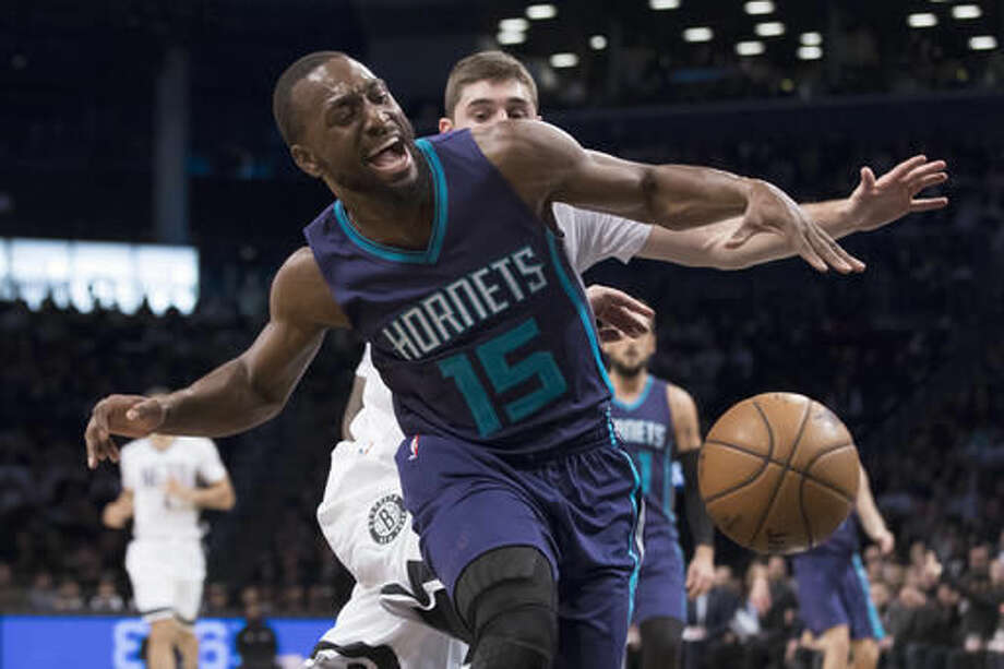 Charlotte Hornets guard Kemba Walker (15) is fouled by Brooklyn Nets guard Joe Harris during the first half of an NBA basketball game, Friday, Nov. 4, 2016, in New York. (AP Photo/Mary Altaffer)