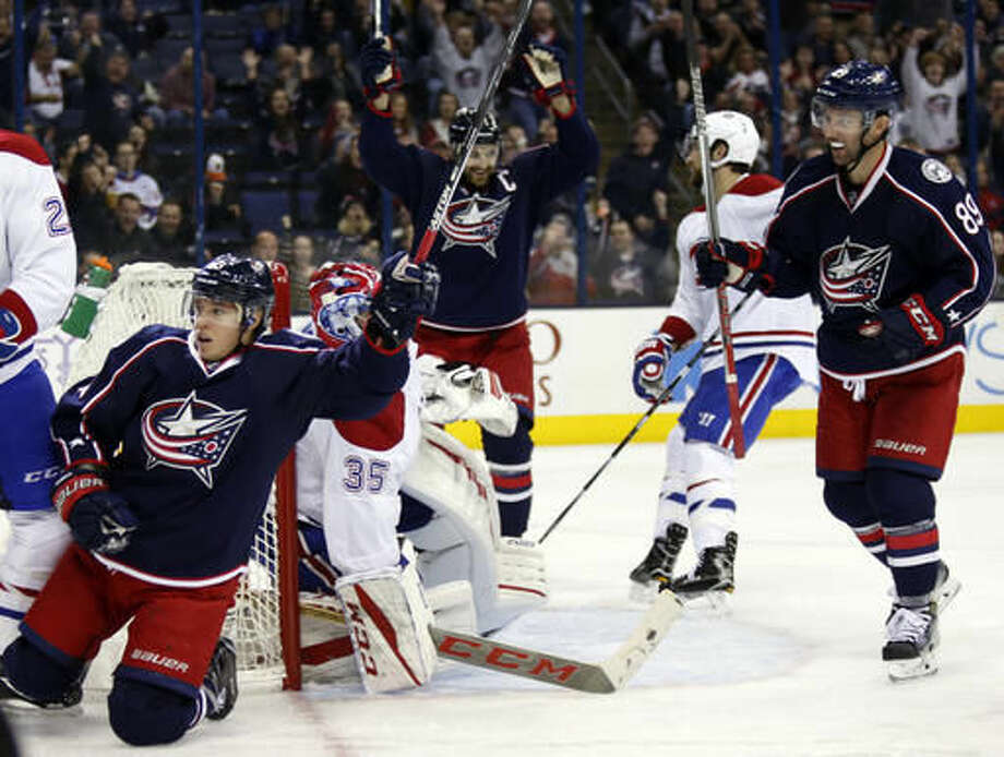 Columbus Blue Jackets forward Cam Atkinson (13) celebrates with forward Sam Gagner (89) after scoring a goal against Montreal Canadiens goalie Al Montoya (35) during the second period of an NHL hockey game in Columbus, Ohio, Friday, Nov. 4, 2016. (AP Photo/Paul Vernon)