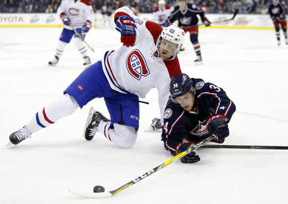 Columbus Blue Jackets defenseman Josh Anderson, right, works for the puck against Montreal Canadiens defenseman Jeff Petry during the second period of an NHL hockey game in Columbus, Ohio, Friday, Nov. 4, 2016. (AP Photo/Paul Vernon)