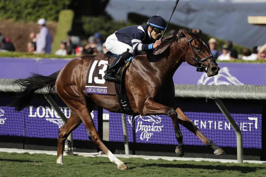 Jockey Jose Ortiz rides Oscar Performance to victory in the Breeders' Cup Juvenile Turf horse race at Santa Anita, Friday, Nov. 4, 2016, in Arcadia, Calif. (AP Photo/Jae C. Hong)