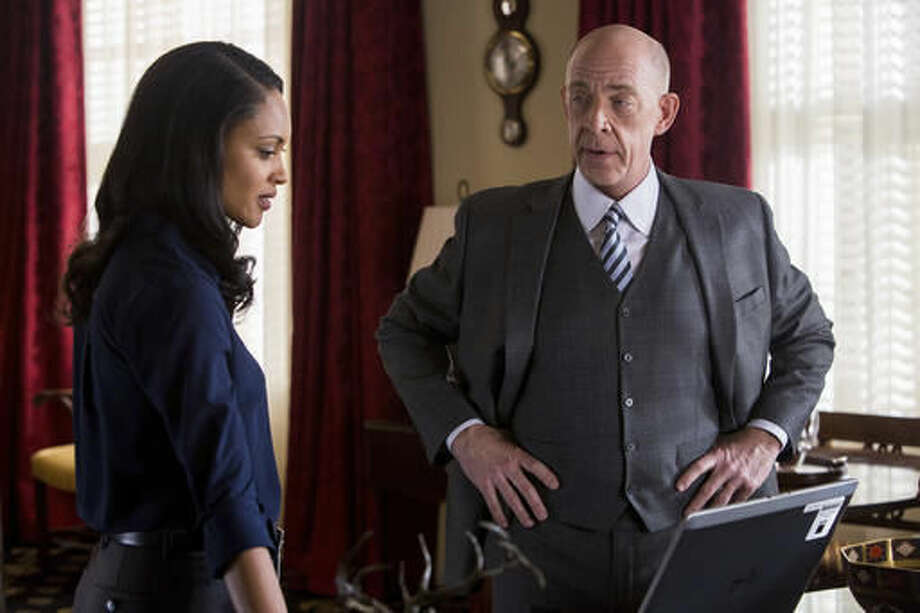 "In this image released by Warner Bros. Pictures, Cynthia Addai-Robinson, left, and J.K. Simmons appear in a scene from ""The Accountant."" (Chuck Zlotnick/Warner Bros. Pictures via AP)"