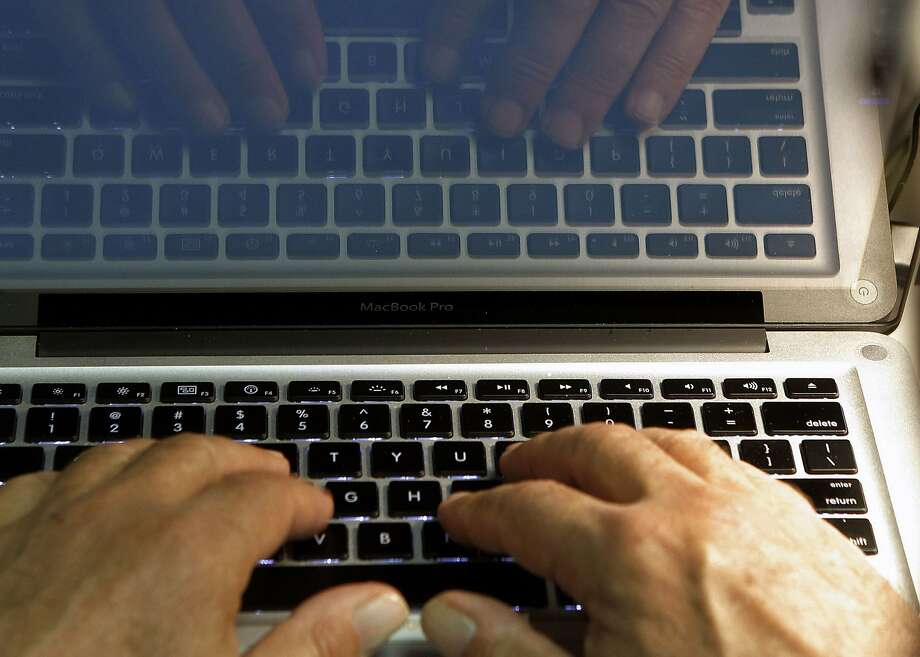 FILE - In this Feb. 27, 2013, file photo illustration, hands type on a computer keyboard in Los Angeles. Tech experts agree that traditional passwords are annoying, outmoded and too easily hacked. Yahoo and Microsoft are offering new log-in solutions via text, facial recognition and fingerprint-identification technology. (AP Photo/Damian Dovarganes, File) Photo: Damian Dovarganes, Associated Press