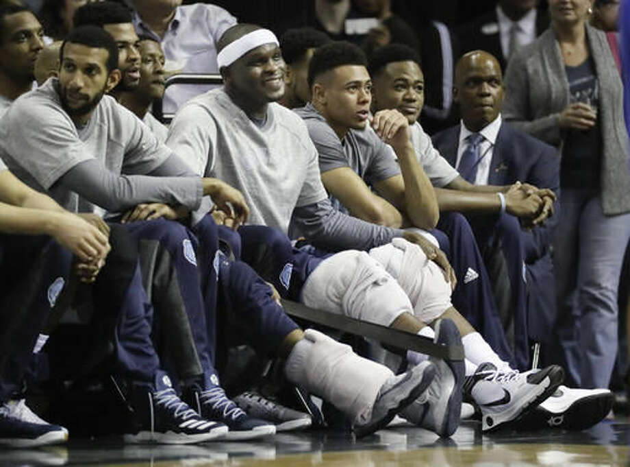 In this Oct. 11, 2016 photo, Memphis Grizzlies forward Zach Randolph, center, sits on the bench with his knees wrapped in ice during the first half of a preseason NBA basketball against the Philadelphia 76ers game in Memphis, Tenn. New Memphis coach David Fizdale has decided that the 6-foot-9 Randolph, who turned 35 this summer, is moving from the starting lineup to the bench this season to help the Grizzlies start games more up-tempo. (AP Photo/Mark Humphrey)
