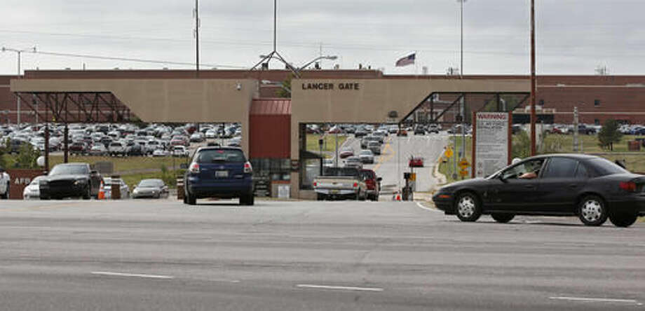 Vehicles drive in and out of Lancer Gate at Tinker Air Force Base in Oklahoma City, Wednesday, Oct. 12, 2016. Oklahoma residents are among those in several states who soon may be required to shell out $110 to buy a passport in order to board a commercial flight or enter federal facilities because of their states' refusal to comply with national proof-of-identity requirements. (AP Photo/Sue Ogrocki)