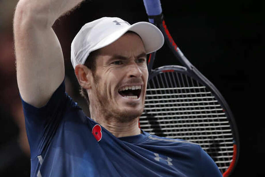 Britain's Andy Murray returns the ball to Tomas Berdych of Czech Republic during the quarterfinal match of the Paris Masters tennis tournament at the Bercy Arena, in Paris, Friday, Nov. 4, 2016. (AP Photo/Christophe Ena)