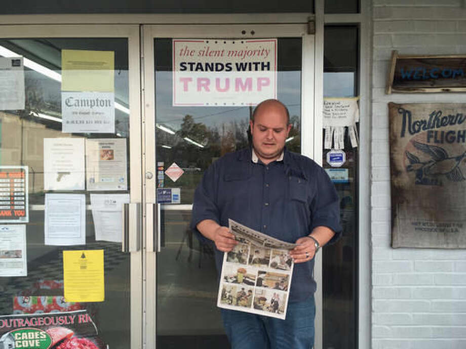 Alan Halsey, who owns the Halsey Country Store in Campton, Ky., holds a copy of the Swift Creek Courier, a community newspaper he recently started, on Wednesday, Nov. 2, 2016. He said he works seven days a week to try to provide for his family, but still struggles. He said he's tired of government regulation and red tape and is supporting Republican presidential candidate Donald Trump. (AP Photo/Claire Galofaro)