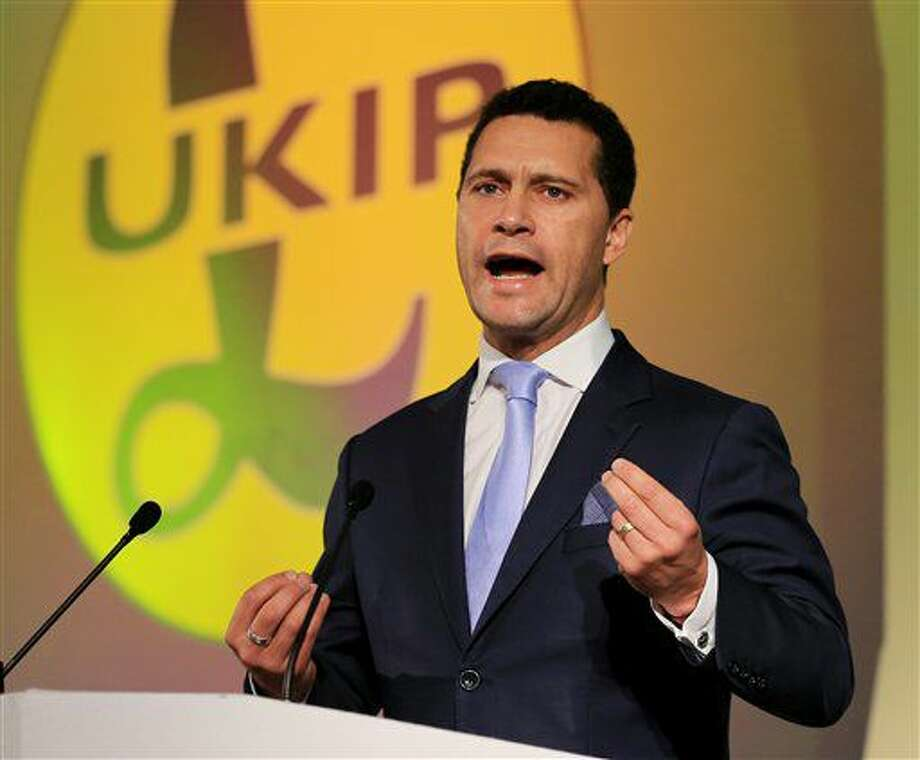 "FILE - In this Sept. 26, 2014 file photo, Steven Woolfe speaks in London. Party leader Nigel Farage said Thursday, Oct. 6, 2016 that ""following an altercation that took place at a meeting of UKIP MEPs this morning ... Steven Woolfe subsequently collapsed and was taken to hospital. His condition is serious."" (Gareth Fuller/PA via AP, File)"