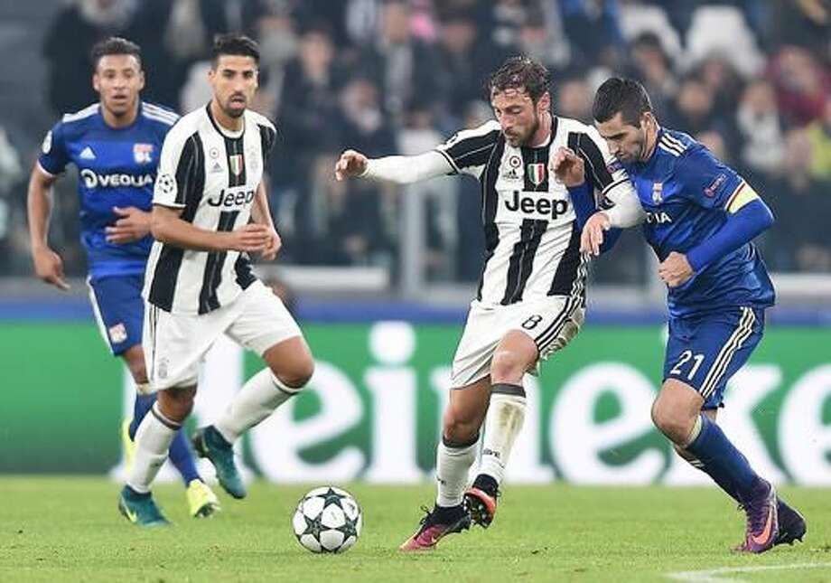 Juventus' Claudio Marchisio and Lyon's Maxime Gonfalons, right, vie for the ball during a Champions League, Group H soccer match between Juventus and Lyon at the Juventus Stadium in Turin, Italy, Wednesday, Nov. 2, 2016. The match ended in a 1-1 draw. (Alessandro Di Marco/ANSA via AP)