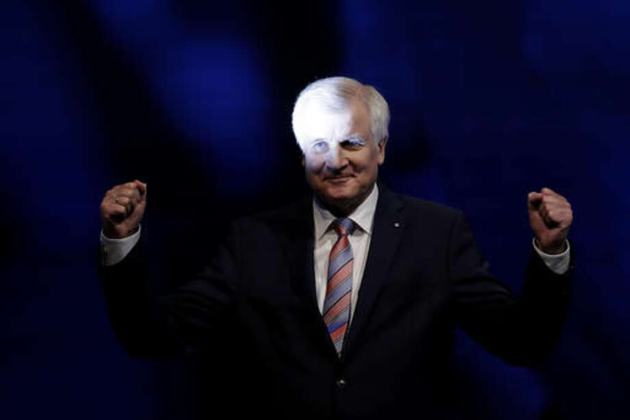 Bavarian State Governor and Chairman of German Christian Social Union party, CSU, Horst Seehofer, poses on the podium after his speech at a party convention of the German Christian Social Union, CSU, in Munich, Germany, Friday, Nov. 4, 2016. (AP Photo/Matthias Schrader)