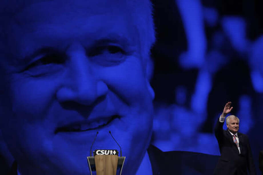 Bavarian State Governor and Chairman of German Christian Social Union party, CSU, Horst Seehofer, waves after his speech at a party convention of the German Christian Social Union, CSU, in Munich, Germany, Friday, Nov. 4, 2016. (AP Photo/Matthias Schrader)