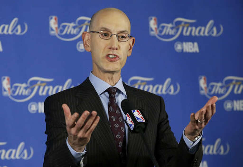 FILE - In this June 2, 2016, file photo, NBA commissioner Adam Silver speaks during a news conference before Game 1 of basketball's NBA Finals between the Golden State Warriors and the Cleveland Cavaliers in Oakland, Calif. Silver said Wednesday, Oct. 12, discussions will resume on the collective bargaining agreement next week after he returns from China, with two months left before a key deadline. (AP Photo/Jeff Chiu, File)