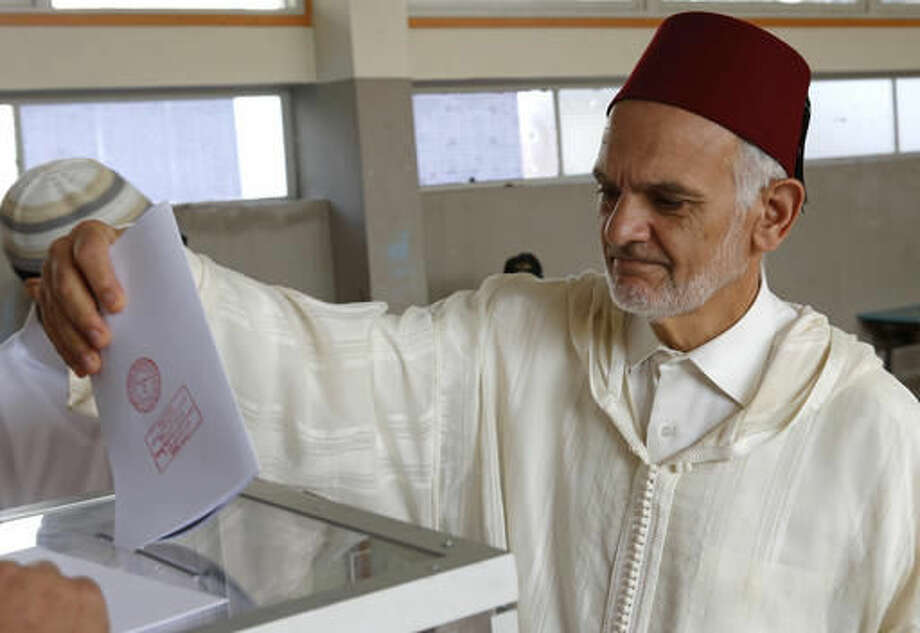 A Moroccan man casts his ballot at a polling station for the parliamentary elections, in Rabat, Morocco, Friday, Oct. 7, 2016. Amid worries about jobs and extremism, millions of Moroccans voted Friday in parliamentary elections that will determine whether moderate Islamists will keep control of the government or lose power to a young rival party close to the powerful royal palace.(AP Photo/Abdeljalil Bounhar)