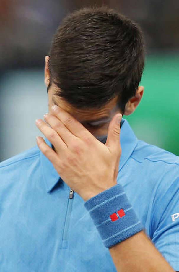 Novak Djokovic of Serbia reacts after loosing a point against Marin Cilic of Croatia during the quarterfinal match of the Paris Masters tennis tournament at the Bercy Arena in Paris, Friday, Nov. 4, 2016. Cilic won 6-4, 7-6. (AP Photo/Michel Euler)