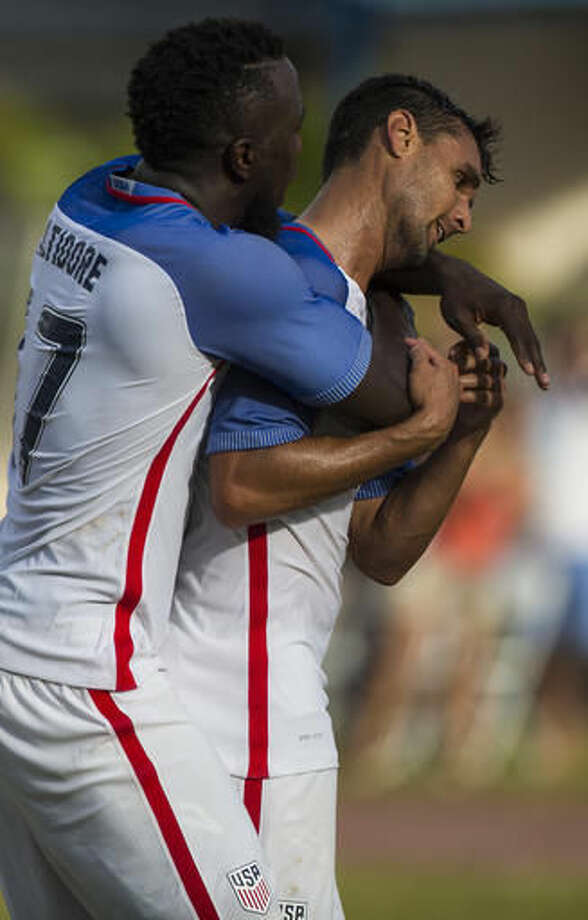 Jozy Altidore, of the U.S., left, congratulates teammate Chris Wondolowski after he scored the first goal against Cuba during their friendly soccer match in the Pedro Marrero Stadium in Havana, Cuba, Friday, Oct. 7, 2016. The U.S. won 2-0. (AP Photo/Desmond Boylan)