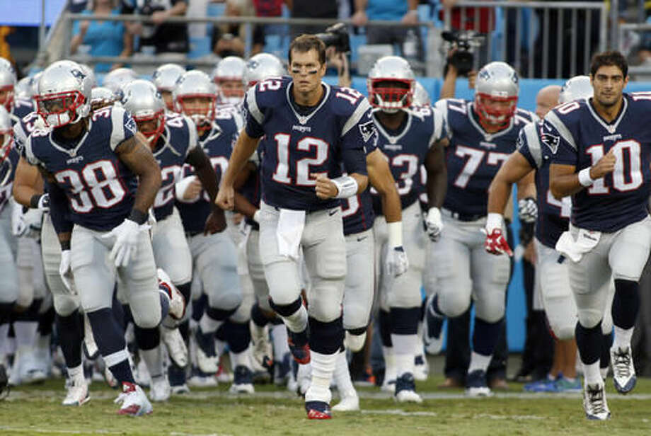 """FILE - In this Aug. 28, 2015, file photo, New England Patriots' Tom Brady (12) leads his team onto the field before a preseason NFL football game against the Carolina Panthers in Charlotte, N.C. The last thing the Browns need right now is a ticked-off superstar quarterback making his return to the NFL. While the ``Deflategate"""" saga might never be forgotten, it's behind the New England Patriots and their four-time Super Bowl champion QB. And, for sure, Brady won't have forgotten the four-game punishment from Commissioner Roger Goodell that he fought to overturn and eventually had to serve. (AP Photo/Bob Leverone, File)"""